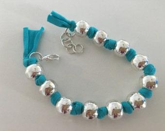Turqoise fabric silver beads