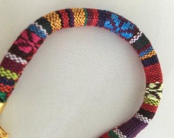 Fabric band peace sign bracelet