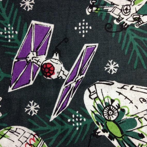 One half yard of fabric material star wars christmas for Space station fabric