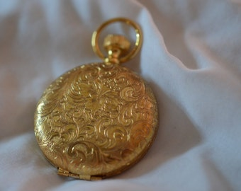 Vintage esteé lauder locket, golden victorian/edwardian style 'clock'-style locket