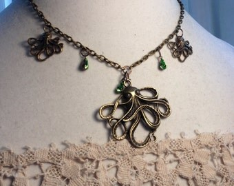 Handmade Antique Brass Octapus Necklace with Green Teardrop Stones.