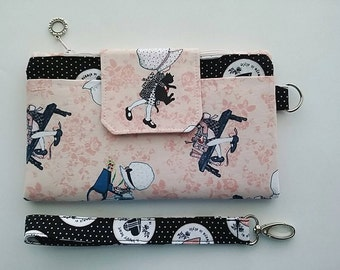 Handmade wallet created with beautiful Holly Hobbie fabrics in the 'Jenna' style design with wristlet strap. Show your style.