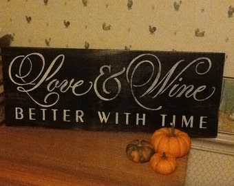 Hand painted distressed love and wine better with time sign