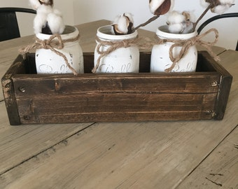 Rustic wooden box with distressed Mason jars