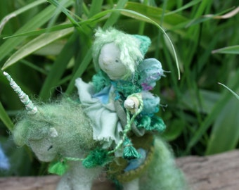 A Green grass fairy with her magical unicorn and two tiny grassling babies, for your waldorf nature table and the wonder of imaginative play