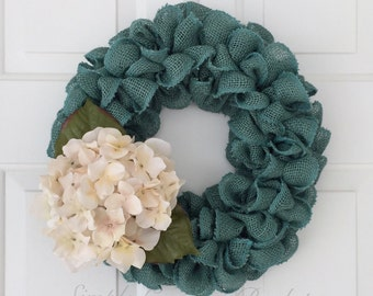 Rustic teal burlap wreath accented with a cream hydrangea beautiful all year round