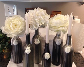 Wedding Centerpiece Owls on silver and oil rubbed bronzed wine bottles....