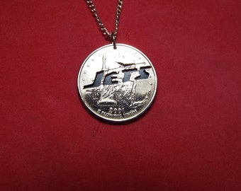 Hand Cut Quarter with the Jets Emblem made into a Necklace
