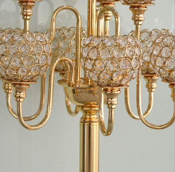 Crystal gold arms candelabra floral riser wedding