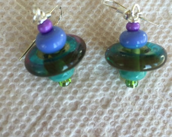 Lampwork Disc earrings with purple and seafoam green spacer beads and seed beads on sterling earwires.