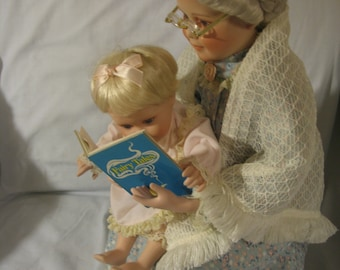 Grandma Doll reading to Baby