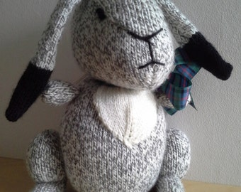 Grey, white and black hare.