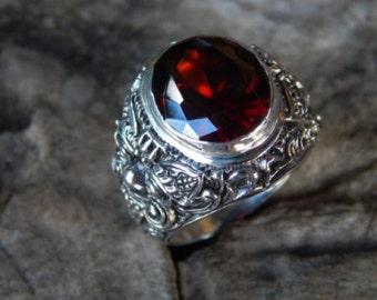Silver ring motif garnet stone Rangda