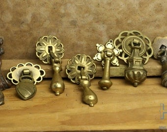 9 Vintage Misc. unmatched, multi finished, Brass Drop Pulls with single center screws Item47