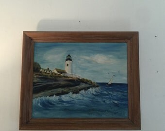 Vintage lighthouse and sailboat painting