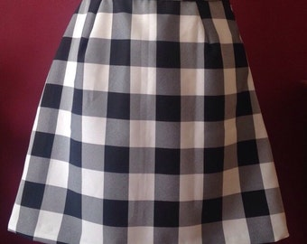 A-line black and white chequered skirt.
