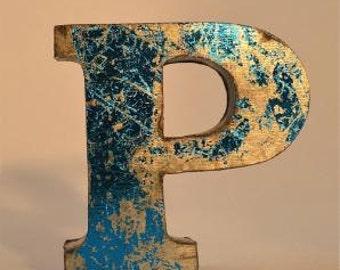 A fantastic vintage style metal 3D blue letter P