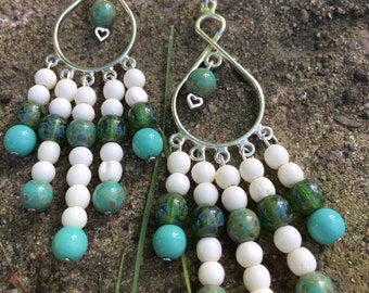 Teal glass and bone chandelier earrings