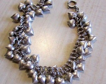 Sterling Silver Charm Bracelet with 44 Puffed Hearts.  7 3/4""