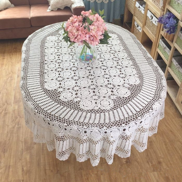 Lace Tablecloths Oval 300x300.jpg Dress up your tables in a different style with this unique oval crocheted  tablecloth patterns!