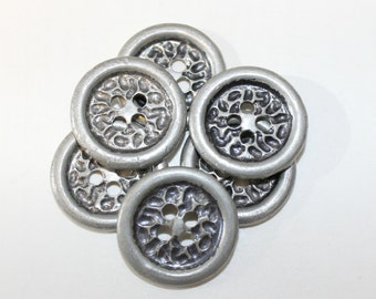 6 silver buttons with pitted design.