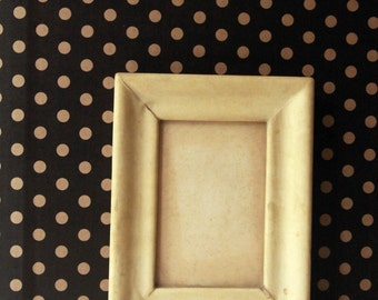Vintage frame in light-skinned first half century 900