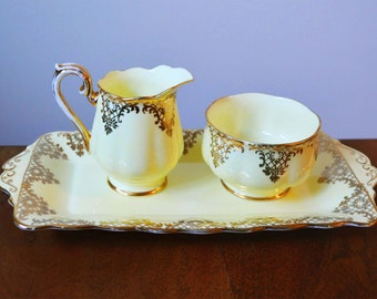 Vintage Royal Albert Cream and Sugar set plus underplate in Pale Yellow and Gold Painted Bone China, made in England