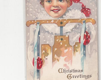 PM 1915 Embossed Antique Postcard Rosy Cheeked Girl With Her Sled Must See