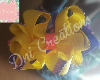 Yellow, purple and pink octopus bow!