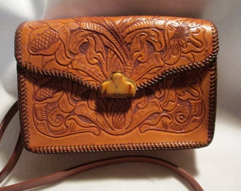 Beautiful Vintage Western Handbag, hand tooled with Exceptional Bakelite Clasp.