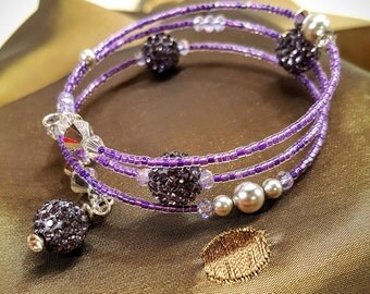 Memory wrap bracelet with Swarovski Crystal CAL crystals, Lavander pave balls, Silver glass pearl, and Myuki seed beads.