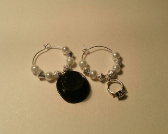 Lovely bride and groom wine charms.