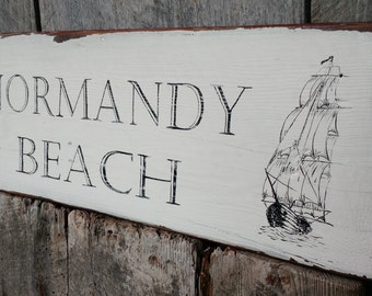 Normandy Beach with Vintage Sailboat hand-painted distressed on reclaimed barn wood
