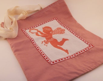 Fully reversible hand embroidered pink cherub tote bag