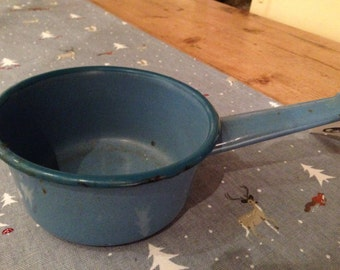 Blue enamelware French milk pan