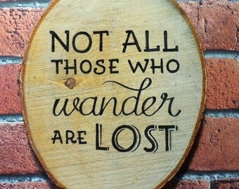 Not All Those Who Wander Are Lost - Inspirational Quote on Rustic Tree Slice.