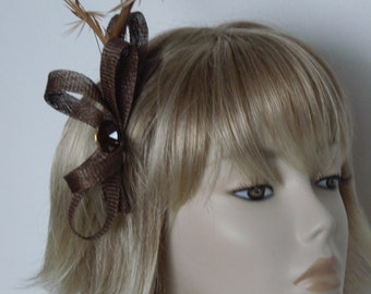 BROWN SINAMAY FASCINATOR, Made of Sinamay, Chestnut Feathers and a acrylic bead,on a comb