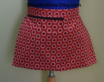 Teacher half apron with 4 pockets, one has zipper for money.  Red South African Shweshwe fabric. Server apron, vendor apron, 8 inch tablet