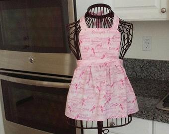 Girls Breast Cancer Awareness apron.