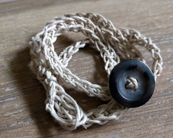 Crochet bracelet made from waxed cotton cord w/ button