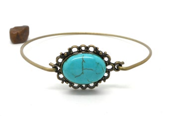 Bangle is rigid cabochon blue imitation turquoise charms and co.