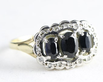 Black sapphire and diamond engagement ring in 9 carat gold for her