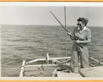 Original Vintage Found Photo Vernacular Photo 1940s Woman Holding Up Caught Fish Fishing Boat Sunglasses 40s -LP43