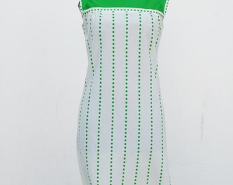 1960s sleeveless bone colored day dress with green polka dots