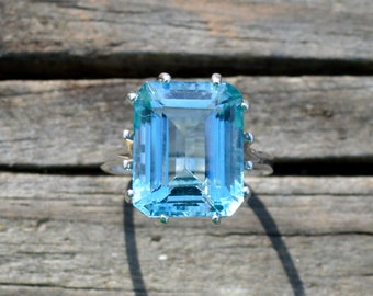 Emerald Cut Blue Topaz Solitaire Ring In Sterling Silver