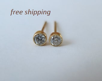 Genuine diamond stud earrings in solid 14 carat  yellow gold.