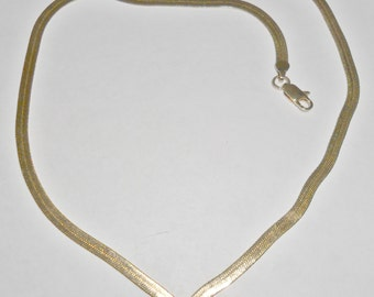 Pretty delicate vintage goldtone herringbone V necklace with clear rhinestone