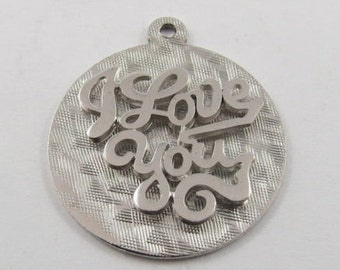 A Sterling Silver Charm that says I Love You.