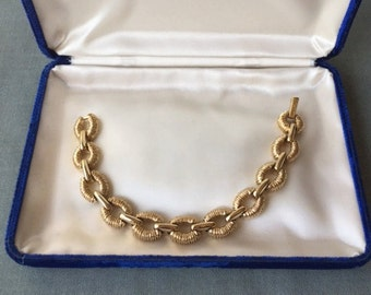 St. John  Bracelet, gold tone chain link style. attention getter, price just reduced