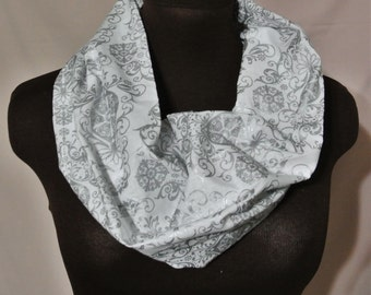 Festive white and silver patterned infinity scarf